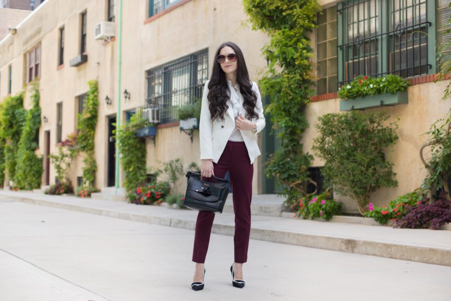 white house black market trophy jacket in white, whbm dotted victorian blouse, whbm comfort stretch slim ankle in burgundy, whbm black and white pumps, foley + corinna carlie satchel in black